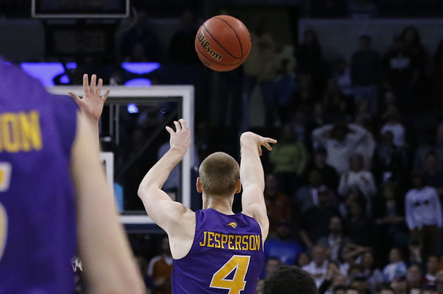 Northern Iowa guard Paul Jesperson shoots a buzzer-beater to win the game for Northern Iowa against Texas in first-round men's college basketball game in the NCAA Tournament, Friday, March 18, 201 ...