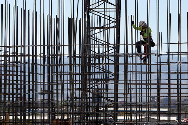A construction worker climbs down rebar on the site of the T-Mobile Arena Sept. 19, 2014, in Las Vegas. Construction has led in recent job growth rate. (Sam Morris/Las Vegas Review-Journal)