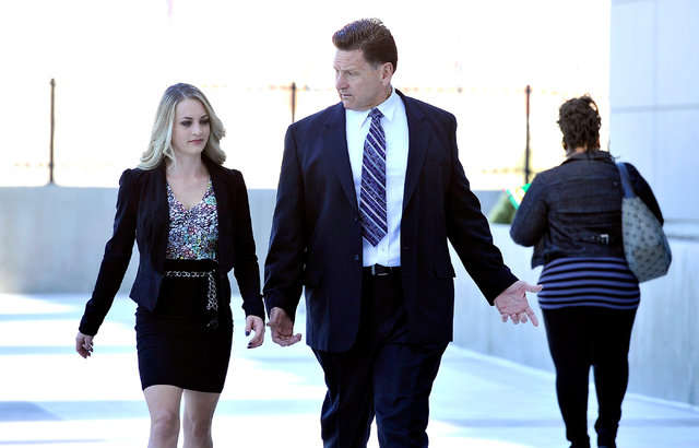 Former Family Court Judge Steven Jones arrives at U.S. Federal Court with his daughter, Ashley Jones, in Las Vegas Wednesday, Feb. 25, 2015. (David Becker/Las Vegas Review-Journal)