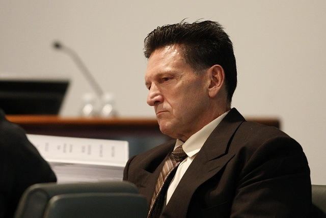 Family Court Judge Steven Jones attends his disciplinary hearing in Las Vegas Wednesday, Dec. 4, 2013. (John Locher/Las Vegas Review-Journal file)