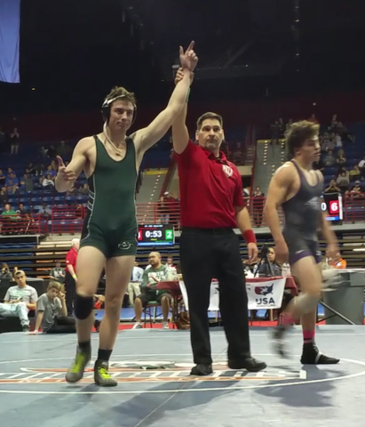A referee holds up the arm of Palo Verde senior Joshua Pine, 18, as he's declared the state winner Feb. 20 in Primm. He is the school's first state wrestling champion athlete in four years. Spec ...
