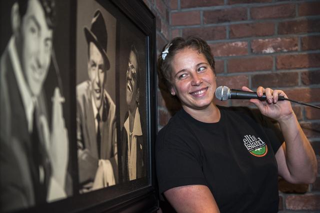 Karaoke jockey Erin Evans aka KJ Vegas Babe poses for a portrait inside the Ellis Island hotel-casino karaoke bar on Friday, Mar. 4, 2016. Evans is a U.S. Army veteran who works as a karaoke jocke ...