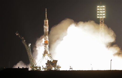 The Soyuz-FG rocket booster with Soyuz TMA-20M capsule carrying a new crew to the International Space Station, ISS, blasts off at the Russian leased Baikonur cosmodrome, Kazakhstan, Saturday, Marc ...
