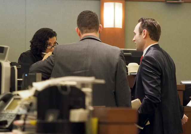 Judge Holly Stoberski, left, listens as the prosecutor, center, and defense attorney Warren Geller, right, hold a sidebar meeting during a hearing in the Jillian Lafave case at the Regional Justic ...