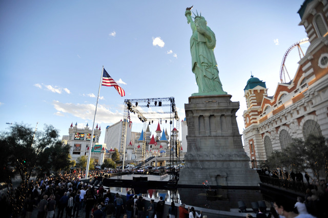 Tourists watch a Cirque du Soleil preview performance in front of the New York New York hotel-casino in Las Vegas on Thursday, Feb. 26, 2015. (David Becker/Las Vegas Review-Journal)