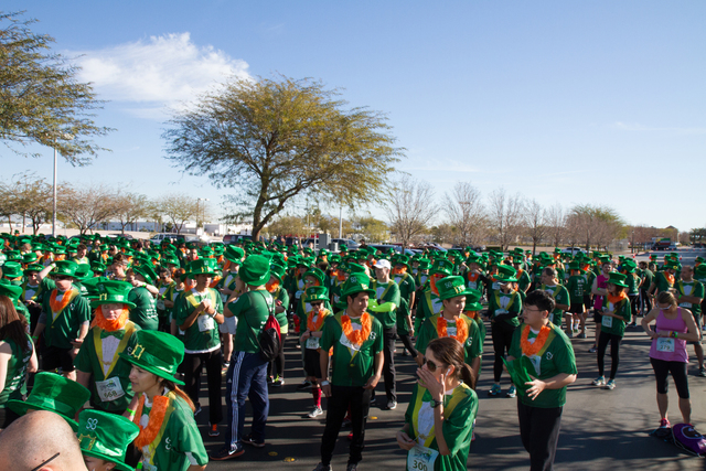 Participants mingle during the St. Baldrick's Lepre-Con 2016, which broke the world record for the largest gathering of people dressed as leprechauns. The final count showed 1,466 participants gat ...