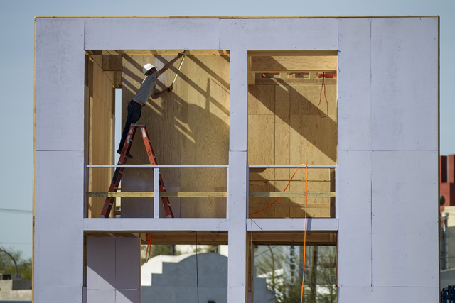Volunteer Jerry Hightower works on a structure for the Life Cube Project is seen at the intersection of 9th Street and Fremont Street on Tuesday, March 15, 2016, in Las Vegas. Erik Verduzco/Las Ve ...