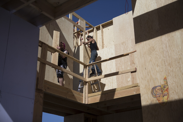 Volunteers work on a structure for the Life Cube Project at the intersection of 9th Street and Fremont Street on Tuesday, March 15, 2016, in Las Vegas. Erik Verduzco/Las Vegas Review-Journal Follo ...