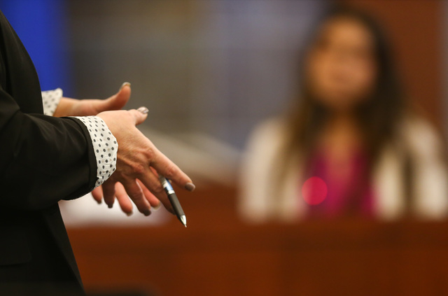 Prosecutor Stacy Kollins questions the student who said she was involved in a sexual relationship with her teacher, Jason Lofthouse, during his trial at the Regional Justice Center in Las Vegas on ...