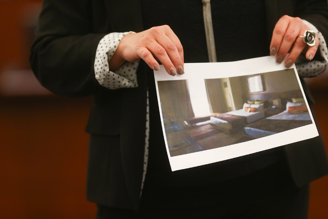 Prosecutor Stacy Kollins shows a photo of a room at the Aliante hotel-casino that Jason Lofthouse sent to a student during his trial at the Regional Justice Center in Las Vegas on Wednesday, March ...