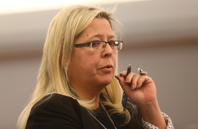 Prosecutor Stacy Kollins questions the student, not pictured, who said she was involved in a sexual relationship with her teacher, Jason Lofthouse, during his trial at the Regional Justice Center  ...