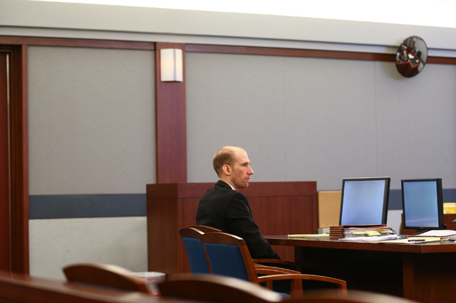 Jason Lofthouse looks on during his trial at the Regional Justice Center in Las Vegas on Tuesday, March 22, 2016. The former Rancho High School teacher faces charges of kidnapping and sexual condu ...