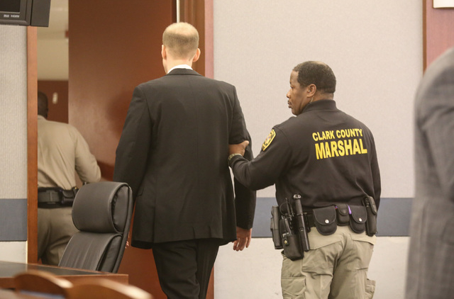 Former Rancho High School teacher Jason Lofthouse is escorted out of the courtroom after being found guilty of kidnapping and sexual conduct with a student at the Regional Justice Center in Las Ve ...