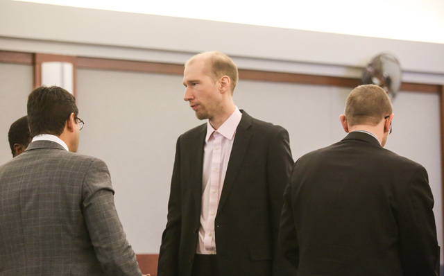 Former Rancho High School teacher Jason Lofthouse reacts after being found guilty of kidnapping and sexual conduct with a student at the Regional Justice Center in Las Vegas on Friday, March 25, 2 ...