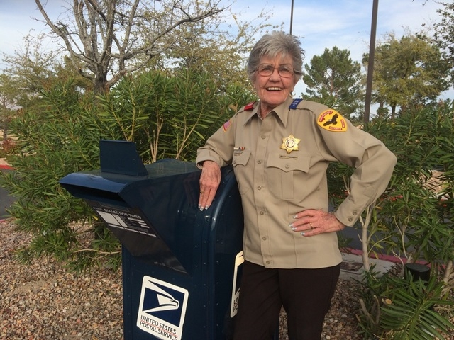 "Lottie Tabor, watch commander for the Sun City Summerlin Security Patrol, points out the type of outgoing letter dropbox deemed most secure if one can't get to the post office. ""Some people wi ..."