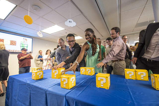 Medical students reach for boxes that contain the location of where they will be doing their residencies during the Match Day ceremony at the University of Nevada School of Medicine in Las Vegas o ...