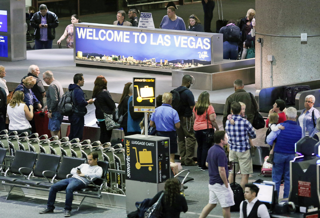 People wait to retrieve luggage at a Southwest Airlines baggage claim at McCarran International Airport Wednesday, March 23, 2016, in Las Vegas. Ronda Churchill/Las Vegas Review-Journal