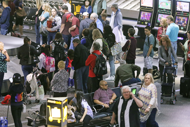 People congregate at baggage claim at McCarran International Airport Wednesday, March 23, 2016, in Las Vegas. Ronda Churchill/Las Vegas Review-Journal