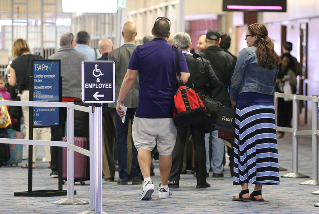 Passengers wait in line at McCarran International Airport security Wednesday, March 23, 2016, in Las Vegas. Ronda Churchill/Las Vegas Review-Journal