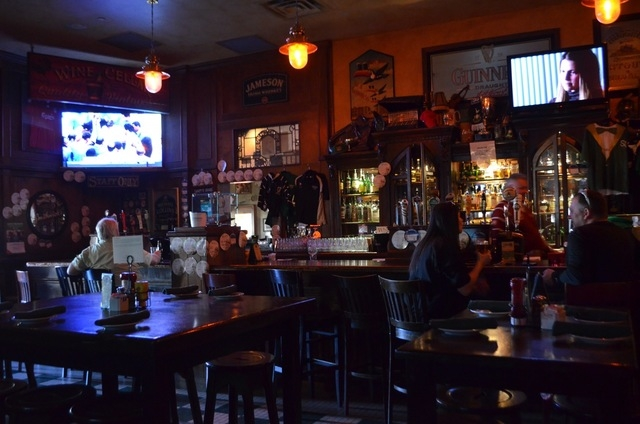 Televisions are mounted over the bar at McMullan's Irish Pub. Ginger Meurer/Special to View