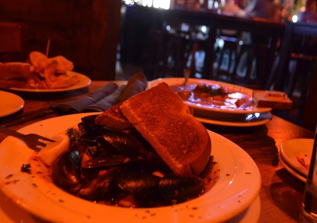 Black mussels with tomato, garlic, shallot and fresh herb broth is served with Texas toast at McMullan's Irish Pub. Ginger Meurer/Special to View