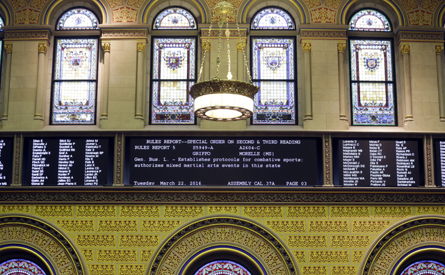 An electronic tote board in the Assembly Chamber displays a mixed martial arts bill that is being debated in the chamber on Tuesday, March 22, 2016, in Albany, N.Y. (Mike Groll/AP)