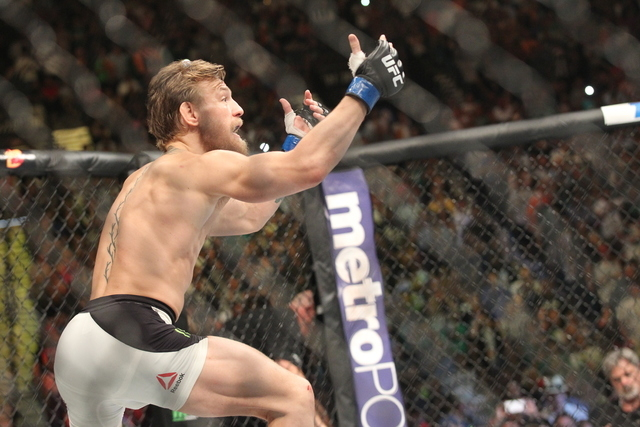 Conor McGregor taunts Chad Mendes during their interim featherweight title bout at UFC 189 at the MGM Grand Garden Arena Saturday, July 11, 2015, in Las Vegas. McGregor won by knockout. (Chase Ste ...