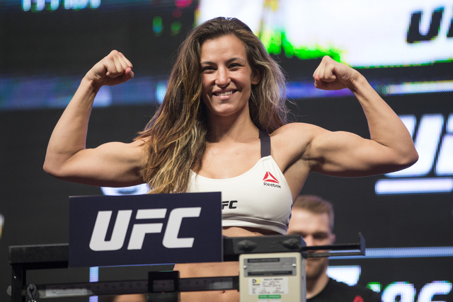 UFC fighter Miesha Tate poses during her weigh-in for UFC 196 at the MGM Grand Garden Arena on Friday, March 4, 2016, in Las Vegas. Tate will fight against Holly Holm Saturday in a title bout. Eri ...
