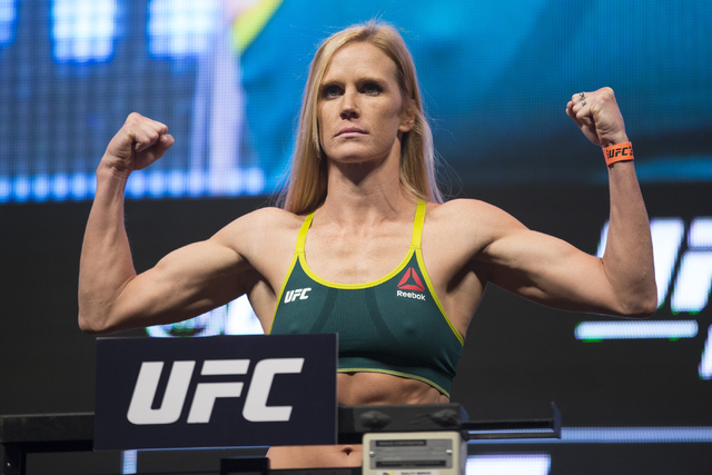 UFC fighter Holly Holm poses during her weigh-in for UFC 196 at the MGM Grand Garden Arena on Friday, March 4, 2016, in Las Vegas. Holm will fight against Miesha Tate Saturday in a title bout. Eri ...