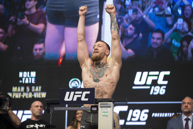 UFC fighter Conor McGregor poses during his weigh-in for UFC 196 at the MGM Grand Garden Arena on Friday, March 4, 2016, in Las Vegas.McGregor will fight Nate Diaz Saturday in a title bout. Erik V ...
