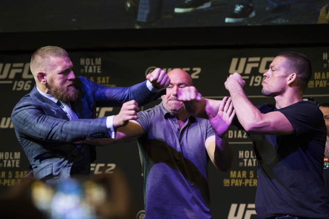 UFC fighters Conor McGregor, left, and Nate Diaz, right, are separated by UFC president Dana White during the UFC 196 press conference face off on Thursday, March 3, 2016, in Las Vegas. Erik Verdu ...