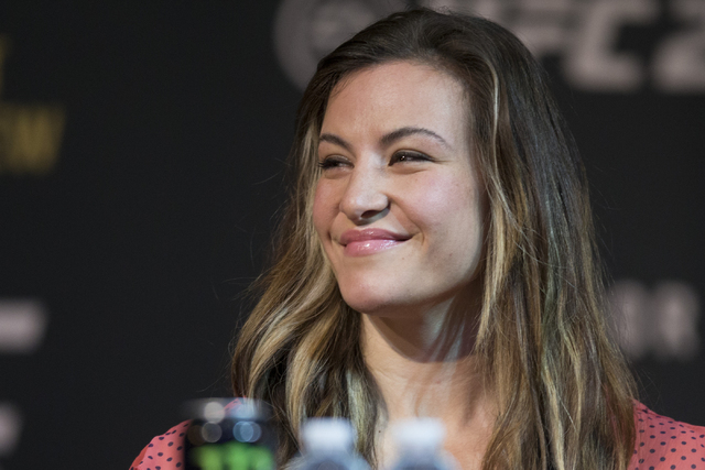 UFC fighter Miesha Tate smiles on stage during the UFC 196 press conference at the MGM Grand casino-hotel on Thursday, March 3, 2016, in Las Vegas. Erik Verduzco/Las Vegas Review-Journal Follow @E ...