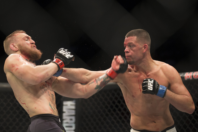 Nate Diaz, right, connects a punch against Conor McGregor in their menճ welterweight bout during UFC 196 at MGM Grand Garden ArenaSaturday, March 5, 2016, in Las Vegas. Diaz won way of submi ...