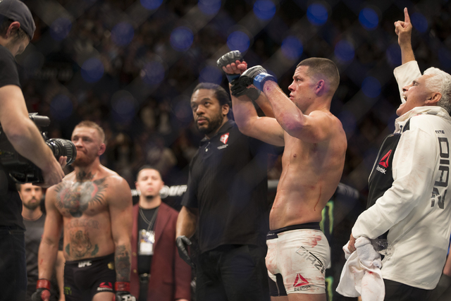 Nate Diaz, right, celebrates his win against Conor McGregor in their menճ welterweight bout during UFC 196 at MGM Grand Garden Arena on Saturday, March 5, 2015 in Las Vegas. Diaz won by way of su ...