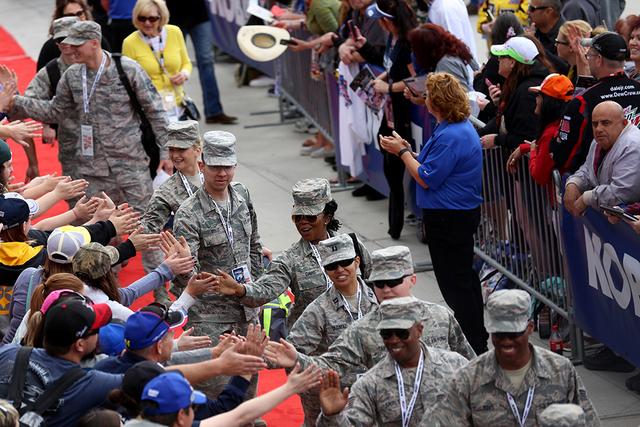 Military members greet the crowd before the start of the Kobalt 400 at Las Vegas Motor Speedway in Las Vegas Sunday, March. 6, 2016. Rachel Aston/Las Vegas Review-Journal Follow @rookie__rae
