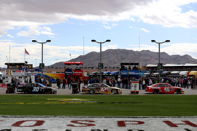 Stock cars for the race are lined up on the track before the start of the Kobalt 400 at Las Vegas Motor Speedway in Las Vegas Sunday, March. 6, 2016. Rachel Aston/Las Vegas Review-Journal Follow @ ...
