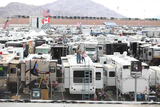 Fans stand on top of a trailer before the start of the Kobalt 400 at Las Vegas Motor Speedway in Las Vegas Sunday, March. 6, 2016. Rachel Aston/Las Vegas Review-Journal Follow @rookie__rae