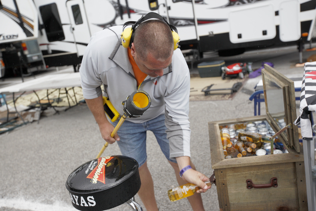 Mike Welter opens a beer before the start of the Kobalt 400 at Las Vegas Motor Speedway in Las Vegas Sunday, March 6, 2016. Rachel Aston/Las Vegas Review-Journal Follow @rookie__rae