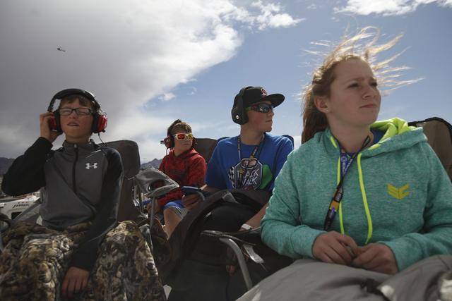 Taycen Birch, from left, Jackson Rogers, Austin Rogers, and Paige Lepre watch as the Kobalt 400 begins at the Las Vegas Motor Speedway in Las Vegas Sunday, March 6, 2016. Rachel Aston/Las Vegas Re ...