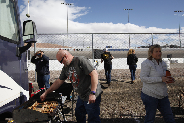Gene Cook barbecues chicken skewers while his party watches the Kobalt 400 race at the Las Vegas Motor Speedway in Las Vegas Sunday, March 6, 2016. Rachel Aston/Las Vegas Review-Journal Follow @ro ...
