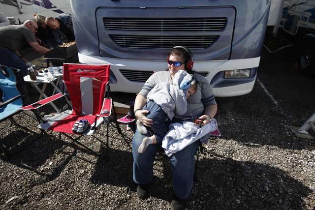 Deanne Bligh holds her son Mackinnon while watching the Kobalt 400 race at the Las Vegas Motor Speedway in Las Vegas Sunday, March 6, 2016. Rachel Aston/Las Vegas Review-Journal Follow @rookie__rae