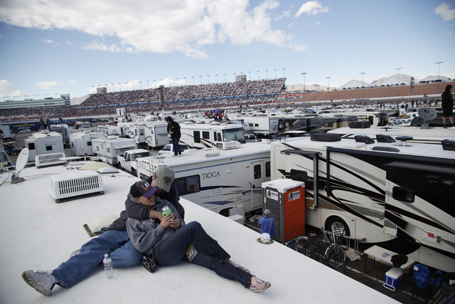 Erin Ruby and George Girgenti watch the Kobalt 400 race from the top of a trailer at the Las Vegas Motor Speedway in Las Vegas Sunday, March 6, 2016. Rachel Aston/Las Vegas Review-Journal Follow @ ...