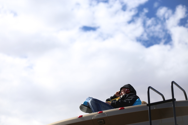 Randy Peters watches the Kobalt 400 race from the top of a trailer at the Las Vegas Motor Speedway in Las Vegas Sunday, March 6, 2016. Rachel Aston/Las Vegas Review-Journal Follow @rookie__rae