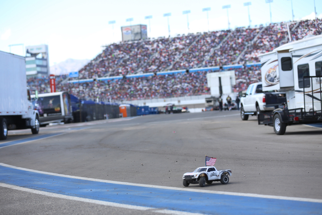 A toy car races around through trailers as the Kobalt 400 race continues at the Las Vegas Motor Speedway in Las Vegas Sunday, March 6, 2016. Rachel Aston/Las Vegas Review-Journal Follow @rookie__rae
