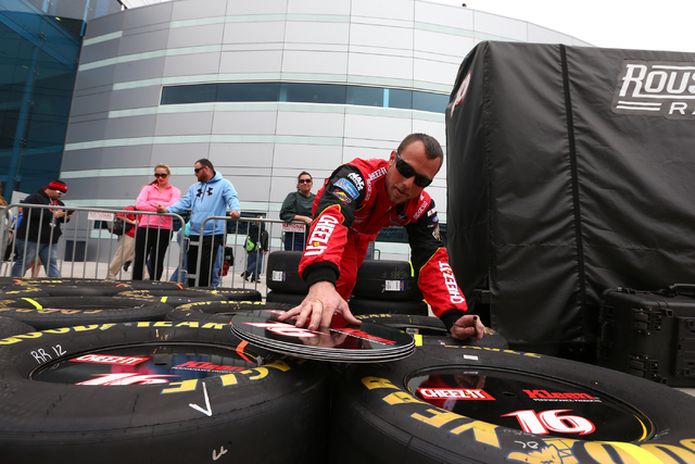 Rear tire changer Curtis Thompson gets tires ready for driver Greg Biffle before the NASCAR Sprint Cup Series Kobalt 400 race at the Las Vegas Motor Speedway in Las Vegas on Sunday, March 6, 2016. ...