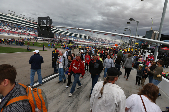 People walk along the pit road area before the NASCAR Sprint Cup Series Kobalt 400 race at the Las Vegas Motor Speedway in Las Vegas on Sunday, March 6, 2016. Chase Stevens/Las Vegas Review-Journa ...