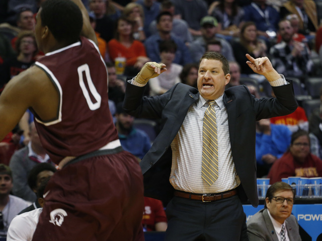 Arkansas Little Rock head coach Chris Beard directs his team against Iowa State during the first half of a second-round men's college basketball game Saturday, March 19, 2016, in the NCAA Tourname ...
