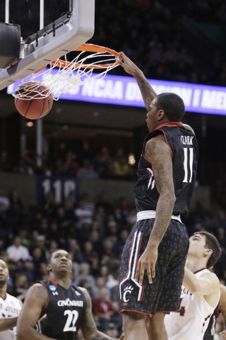 Cincinnati forward Gary Clark (11) dunks during the second half of a first-round men's college basketball game against Saint Joseph's in the NCAA Tournament in Spokane, Wash., Friday, March 18, 20 ...