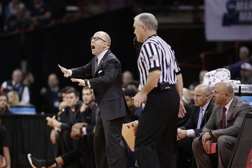 Cincinnati head coach Mick Cronin, left, instructs his team during the second half of a first-round men's college basketball game against Saint Joseph's in the NCAA Tournament in Spokane, Wash., F ...