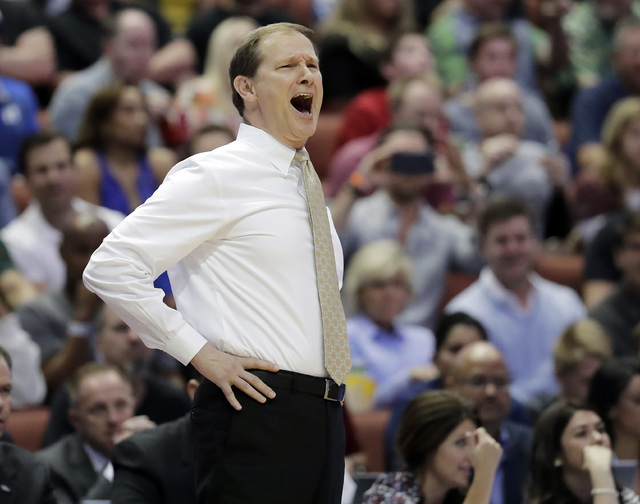 Oregon head coach Dana Altman yells to his team during the first half of an NCAA college basketball game against Duke in the regional semifinals of the NCAA Tournament, Thursday, March 24, 2016, i ...